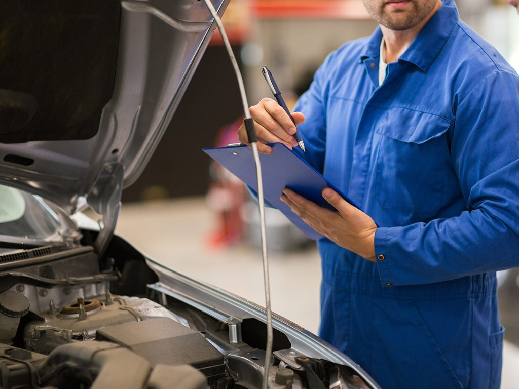 mechanic interacts with a customer
